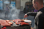 Man grilling sausages in Old Town Square, Prague, Czech Republic, historical center listed as World Heritage by UNESCO, the old town (Stare Mesto), Old town Square (Staromestske namesti), Europe