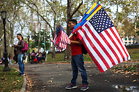A man sells flags while Immigrants take part in a rally in support of the Immigrant reform in New York,  Oct 5, 2013, Photo by Eduardo Munoz Alvarez / VIEWpress.