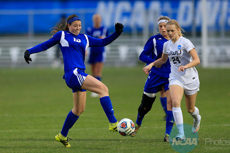 KANSAS CITY, MO - DECEMBER 03:  Marti Corby (13) of Grand Valley State University and Becca Cates (24) of Western Washington University battle for the ball during the Division II Women's Soccer Championship held at Children's Mercy Victory Field at Swope Soccer Village on December 03, 2016 in Kansas City, Missouri. Western Washington University beat Grand Valley State University 3-2 to win the national title.  (Photo by Jack Dempsey/NCAA Photos via Getty Images)