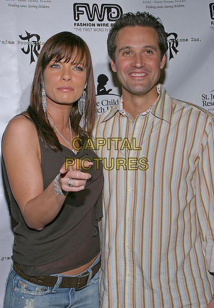 "JAIME PRESSLY & TOM  BREITLING .""A Gamble For Hope"" An Exclusive Casino after-party to benefit St. Jude Children's Research Hospital held at Bliss Lounge, Los Angeles, California, 25th October 2004..half length Jamie Pressley pointing gesture.**UK SALES ONLY**.Ref: ADM.www.capitalpictures.com.sales@capitalpictures.com.©JW/AdMedia/Capital Pictures"