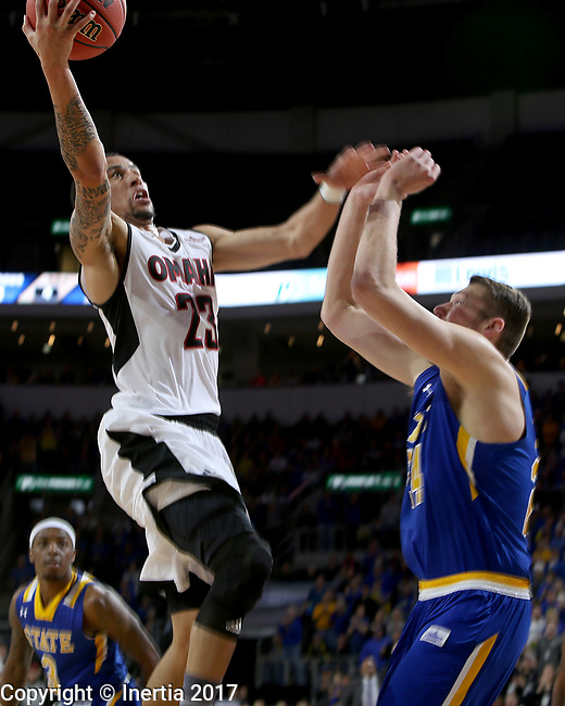 SIOUX FALLS, SD: MARCH 7: Marcus Tyus #23 from Omaha takes. The ball to the basket against Mike Daum #24 from South Dakota State University during the Men's Summit League Basketball Championship Game on March 7, 2017 at the Denny Sanford Premier Center in Sioux Falls, SD. (Photo by Dave Eggen/Inertia)
