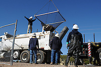 Scottsdale, Arizona (January 12, 2013) - As part of a seven-year plan to dry up all portions of its 131-mile canal system, Salt River Project (SRP), relocated the White Amur fish they used as an environmentally friendly and cost effective alternative to herbicides and heavy machinery for vegetation control. White Amur fish are temporarily trapped in a net being lifted by a crane truck to be transferred to another portion of the 131-mile SRP's system where water still flows. Fish are used by SRP to gobble weeds from the canal bottoms. Photo by Eduardo Barraza © 2013