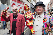 Covent Garden, London, UK. 11 May 2014. The festival starts with a procession around the streets of Covent Garden. Puppeteers with puppets. The Covent Garden May Fayre and Puppet Festival takes place at St Paul's Church.