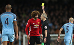 Marouane Fellaini of Manchester United is given a yellow card by referee Martin Atkinson during the English Premier League match at The Etihad Stadium, Manchester. Picture date: April 27th, 2016. Photo credit should read: Lynne Cameron/Sportimage