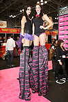 Models pose on stilts at the Enzo Milano booth during the 2013 International Beauty Show at the Javits Convention Center in New York City on April 15, 2013.
