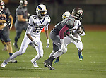 Torrance, CA 09/25/15 - Landon Sharp (El Segundo #15) and Jerome Duhon (Torrance #1) in action during the El Segundo - Torrance varsity football game at Zamperini Field of Torrance High School