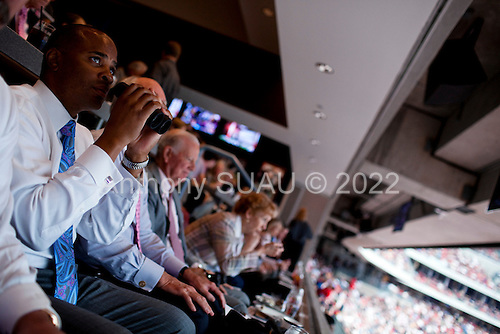 Houston, Texas<br /> October 2, 2011<br /> <br /> General manager and first as executive vice president, Rick Smith (with binoculars) watch the second and third quarters from a skybox. <br /> <br /> The Houston Texans defeated the Pittsburgh Steelers at the Reliant Stadium 17 to 10.