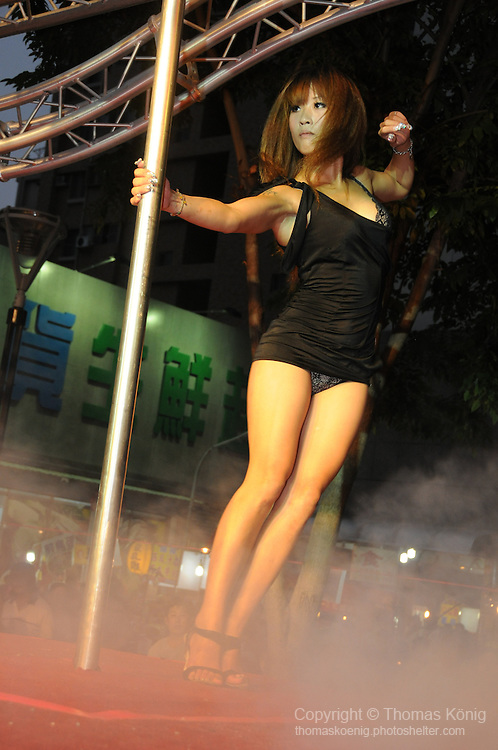 Bao-Jhong Yi-min Temple, Kaohsiung -- Pole dancer performing at the annual 'Divine Pig' (Shen Zhu) festival during Ghost Month.