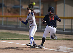 Wildcats' Jenny Rechel makes a play against Snow College's Kayla Larsen at Edmonds Sports Complex in Carson City, Nev., on Friday, March 6, 2014. <br /> Photo by Cathleen Allison/Nevada Photo Source