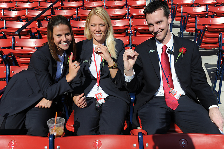-Boston, MA, April 20, 2012-<br /> <br /> Red Sox Ambassadors, from left, Jackie Dempsey, Lynn Herman and Pete Smith gesture &quot;100&quot; at the start of the day. <br /> <br /> (Photo by Michael Ivins/Boston Red Sox)
