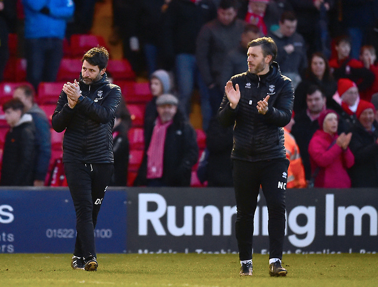 Lincoln City manager Danny Cowley, left, and Lincoln City's assistant manager Nicky Cowley applauds the fans at the final whistle<br /> <br /> Photographer Andrew Vaughan/CameraSport<br /> <br /> The EFL Sky Bet League Two - Lincoln City v Northampton Town - Saturday 9th February 2019 - Sincil Bank - Lincoln<br /> <br /> World Copyright &copy; 2019 CameraSport. All rights reserved. 43 Linden Ave. Countesthorpe. Leicester. England. LE8 5PG - Tel: +44 (0) 116 277 4147 - admin@camerasport.com - www.camerasport.com