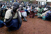 Children wait to leave Noah's Ark Ministries night commmuter center in Gulu after spending another night away from their families in the safety of the city limits. They walk into the city at night to avoid abduction by the Lord's Resistance Army in their villages. January 24, 2004. The camp usually hosts about 2,000 children each night and is one of many centers around the city. (Rick D'Elia)