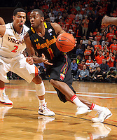 Jan. 27, 2011; Charlottesville, VA, USA; Maryland Terrapins guard Adrian Bowie (1) drives past Virginia Cavaliers guard Mustapha Farrakhan (2) during the game at the John Paul Jones Arena. Mandatory Credit: Andrew Shurtleff