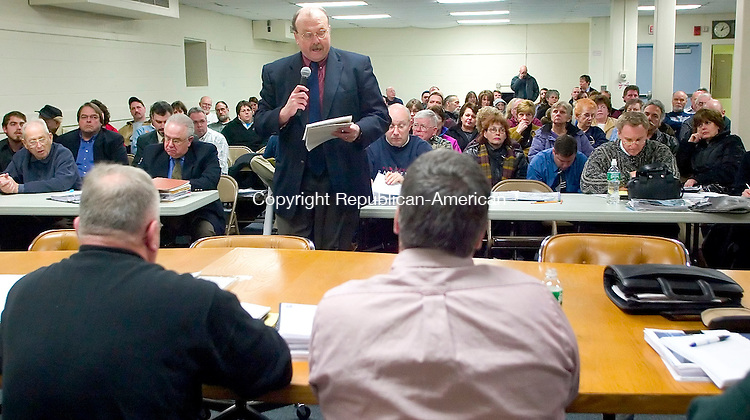 SEYMOUR, CT- 31 JAN 07- 013107JT01- <br /> John Lambert, a land-use attorney representing Seymour residents, speaks to the Planning and Zoning Commission at the Seymour Community Center on Wednesday evening during a public hearing regarding the proposal of a commercial driving school on Pearl Street.<br /> Josalee Thrift Republican-American