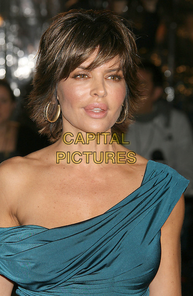 "LISA RINNA .""The Curious Case of Benjamin Button"" Los Angeles Premiere held at Mann's Village Theatre, Westwood, California, USA..December 8th, 2008.headshot portrait gold hoop earrings  blue off the shoulder .CAP/ADM/MJ.©Michael Jade/AdMedia/Capital Pictures."