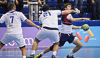 02 NOV 2011 - LONDON, GBR - Britain's Gawain Vincent (right in blue and red) is tackled by Israel's Omer Jacob Davda (#21, in white) during the Men's 2013 World Handball Championship qualification match at the National Sports Centre at Crystal Palace .(PHOTO (C) NIGEL FARROW)
