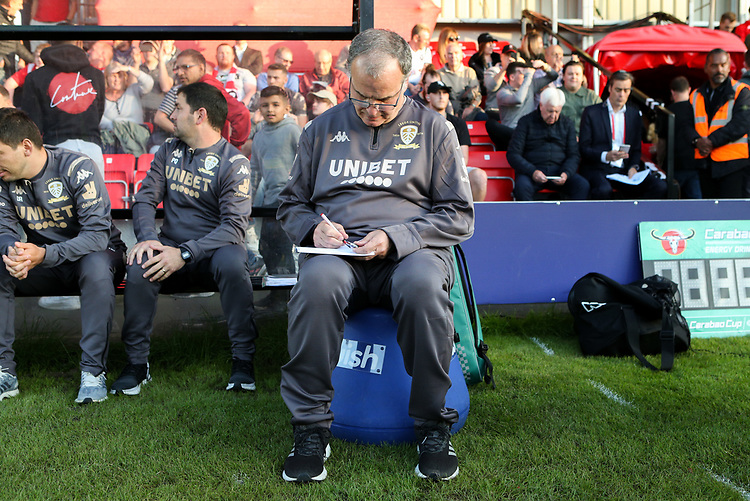 Leeds United manager Marcelo Bielsa makes notes <br /> <br /> Photographer Alex Dodd/CameraSport<br /> <br /> The Carabao Cup First Round - Salford City v Leeds United - Tuesday 13th August 2019 - Moor Lane - Salford<br />  <br /> World Copyright © 2019 CameraSport. All rights reserved. 43 Linden Ave. Countesthorpe. Leicester. England. LE8 5PG - Tel: +44 (0) 116 277 4147 - admin@camerasport.com - www.camerasport.com