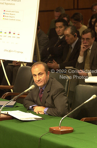 Jacques A. Nasser, President and Chief Executive Officer, Ford Motor Company, Inc.  testifies before the U.S. Senate Commerce Committee on the Firestone tire recall in Washington, D.C. on September 12, 2000. Bridgestone/Firestone executives including Chief Executive Officer Masatoshi Ono are seated behind Mr. Nasser..Credit: Ron Sachs / CNP