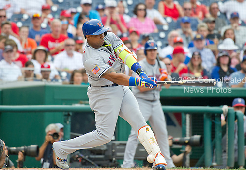 New York Mets left fielder Yoenis Cespedes (52) seemingly hits a ball off his foot in the first inning against the Washington Nationals at Nationals Park in Washington, D.C. on Monday, July 3, 2017.  It was scored as a fair ball for a single.<br /> Credit: Ron Sachs / CNP<br /> (RESTRICTION: NO New York or New Jersey Newspapers or newspapers within a 75 mile radius of New York City)