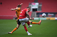 8th July 2020; Ashton Gate Stadium, Bristol, England; English Football League Championship Football, Bristol City versus Hull City; Kevin Stewart of Hull City tries to block the clearance from Jack Hunt of Bristol City