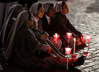 "Suore partecipano ad una fiaccolata in Piazza San Pietro, nel cinquantesimo anniversario dell'apertura del Concilio Vaticano II e del ""Discorso alla Luna"", in Vaticano, 11 ottobre 2012..Nuns attend a torchlight procession in St. Peter's square, to mark the 50th anniversary of the opening of the Second Vatican Council and of the ""Speech to the Moon"", at the Vatican, 11 october 2012..UPDATE IMAGES PRESS/Riccardo De Luca"