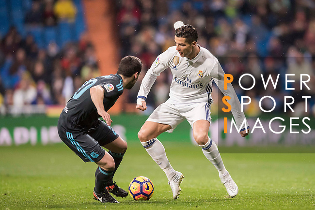 Cristiano Ronaldo (r) of Real Madrid competes for the ball with Joseba Zaldua Bengoechea of Real Sociedad during their La Liga match between Real Madrid and Real Sociedad at the Santiago Bernabeu Stadium on 29 January 2017 in Madrid, Spain. Photo by Diego Gonzalez Souto / Power Sport Images