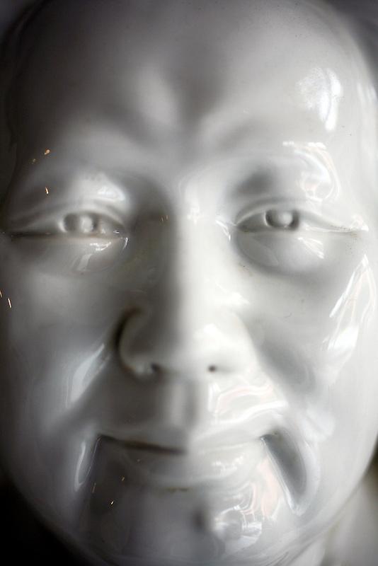 A porcelian image of Chairman Mao Zedong for sale in a shop in Jingdezhen June 26, 2006.