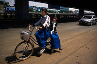 13 year old Lanjar Arum Sari (back) and her 14 year old sister Siti Rahayu bike back from Kartini Emergency School. Since the early 1990s, twin sisters Sri Rosyati (known as Rossy) and Sri Irianingsih (known as Rian) have used their family inheritance to set up and run 64 schools in different parts of Indonesia, providing primary education combined with practical skills to some of the country's most deprived children.