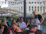 """Chef Dave Holman greets guests during the """"Reno Taste"""" launch party  Tuesday, June 13, 2017 on the terrace of Campo Reno."""