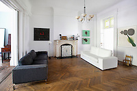 contemporary living room<br /> <br /> Spanish artist Lluis Lleo lives with his family in this two story brownstone in the East Village in New York City.