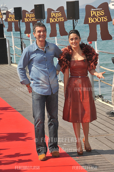 "Antonio Banderas & Salma Hayek at the photocall for their new animated movie ""Puss in Boots"" at the 64th Festival de Cannes..May 11, 2011  Cannes, France.Picture: Paul Smith / Featureflash"