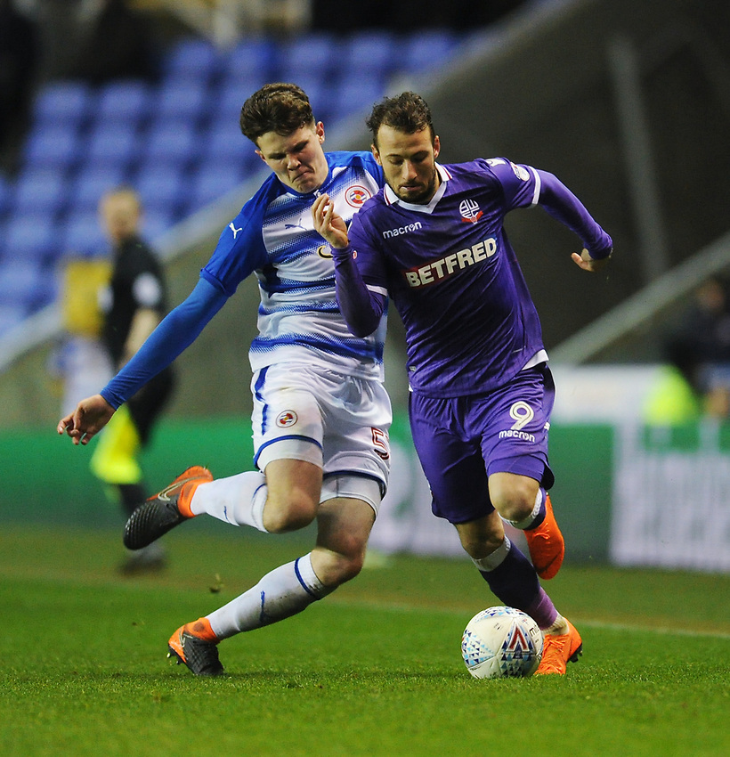 Bolton Wanderers' Adam Le Fondre is tackled by Reading's Tom Holmes<br /> <br /> Photographer Kevin Barnes/CameraSport<br /> <br /> The EFL Sky Bet Championship - Reading v Bolton Wanderers - Tuesday 6th March 2018 - Madejski Stadium - Reading<br /> <br /> World Copyright &copy; 2018 CameraSport. All rights reserved. 43 Linden Ave. Countesthorpe. Leicester. England. LE8 5PG - Tel: +44 (0) 116 277 4147 - admin@camerasport.com - www.camerasport.com