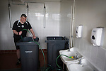 Elgin City 3 Edinburgh City 0, 13/08/2016. Borough Briggs, Scottish League Two. A member of the backroom staff fills bins for ice baths in the away dressing room at Borough Briggs, home to Elgin City, on the day they played SPFL2 newcomers Edinburgh City. Elgin City were a former Highland League club who were elected to the Scottish League in 2000, whereas Edinburgh City became the first club to gain promotion to the League by winning the Lowland League title and subsequent play-off matches in 2015-16. This match, Edinburgh City's first away Scottish League match since 1949, ended in a 3-0 defeat, watched by a crowd of 610. Photo by Colin McPherson.