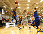 SIOUX FALLS, SD - NOVEMBER 24: Bryant Allen #3 from Dakota State University leaps for the loose ball past Cutler Finneman #50 from the University of Sioux Falls in the first half of their game Monday night at the Stewart Center.  (Photo by Dave Eggen/Inertia)