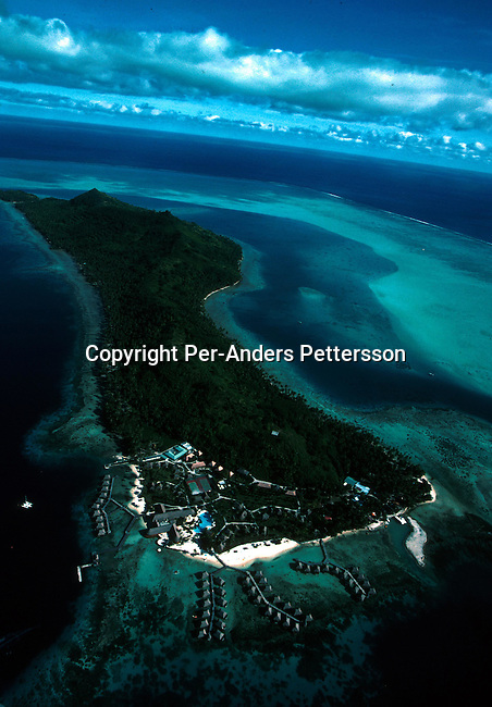 An aerial view of a resort hotel on April 18, 1997 on Bora Bora, a paradise island in French Polynesia. The Island is a playground for rich tourists and Hollywood stars as it provides total security and privacy. Most local people live of the tourism industry usually working in one of the luxury resorts. .Photo: Per-Anders Pettersson/ iAfrika Photos