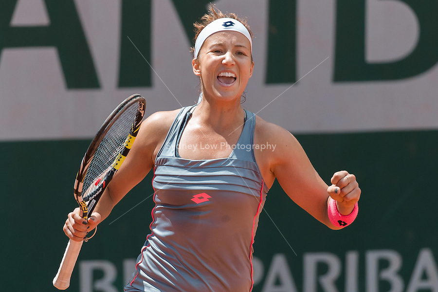May 25, 2015: Paula Kania (POL) celebrates her win in a 1st round match against  Mona Barthel (GER) on day two of the 2015 French Open tennis tournament at Roland Garros in Paris, France. Kania won 57 62 64. Sydney Low/AsteriskImages