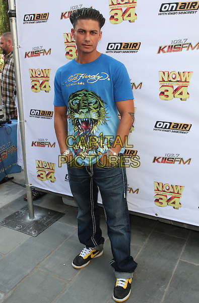"PAUL ""PAULY D"" DELVECCHIO.KIIS-FM Hosts ""Now 34 And The Jersey Shore"" Pool Party held at Hollywood Tower, Hollywood, CA , USA, .10th July 2010..Full length blue ed hardy t-shirt jeans hands in pockets trainers back yellow nike .CAP/ADM/KB.©Kevan Brooks/AdMedia/Capital Pictures."