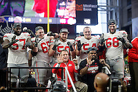 Ohio State Buckeyes offensive line and running back Ezekiel Elliott (15) pose for a photo with  Ed Warinner the Offensive Coordinator and Offensive Line Coach after beating Notre Dame Fighting Irish during the Fiesta Bowl in the University of Phoenix Stadium on January 1, 2016.  (Dispatch photo by Kyle Robertson)