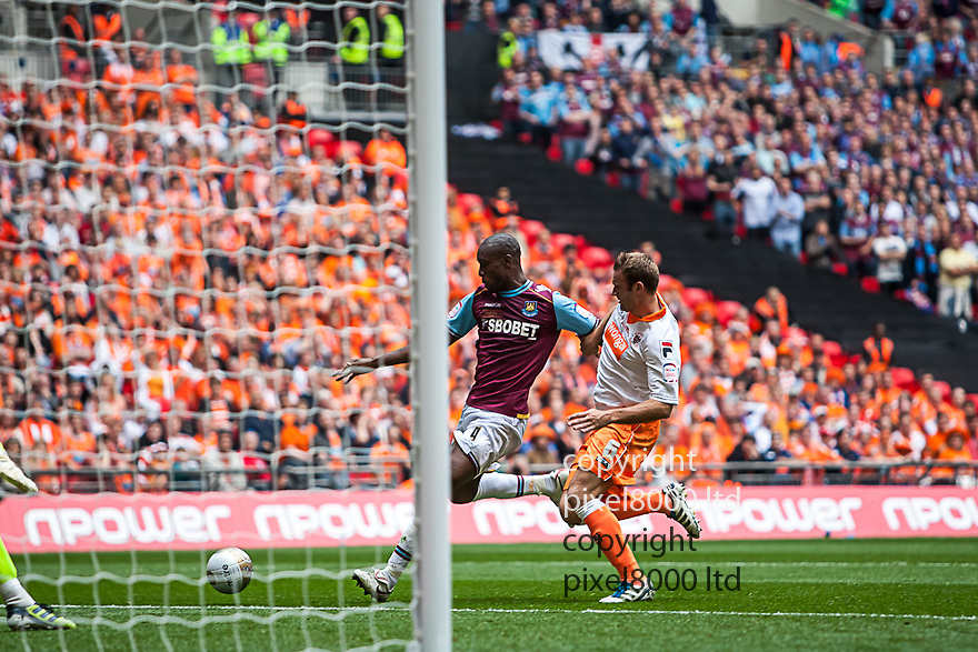 London, UK. West Ham striker lines up his shot to fire past Blackpool keeper Matthew Gilks during nPower Championship playoff final fixture Blackpool versus West Ham United at Wembley Stadium 19 May.  Please Byline David Fearn Pixel 8000 Ltd