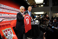 United States Soccer Federation President Sunil Gulati presents new US Men's National Team Head Coach Jurgen Klinsmann with a jersey during a press conference at NIKETOWN in New York, NY, on August 01, 2011.