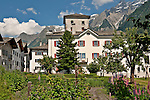 Houses, a garden, and a view of the mountains in the small town of Viscoprano in the Swiss valley of Bregaglia