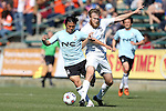 08 March 2015: Carolina's Connor Tobin (right) fouls E-Land's Kim Min-Je (KOR) (left). The Carolina RailHawks of the North American Soccer League played Seoul E-Land FC of the K-League Challenge at WakeMed Stadium in Cary, North Carolina in a 2015 preseason friendly for both clubs. The game ended in a 0-0 tie. Afterwards, Seoul E-Land won a penalty kick shootout 5-4.