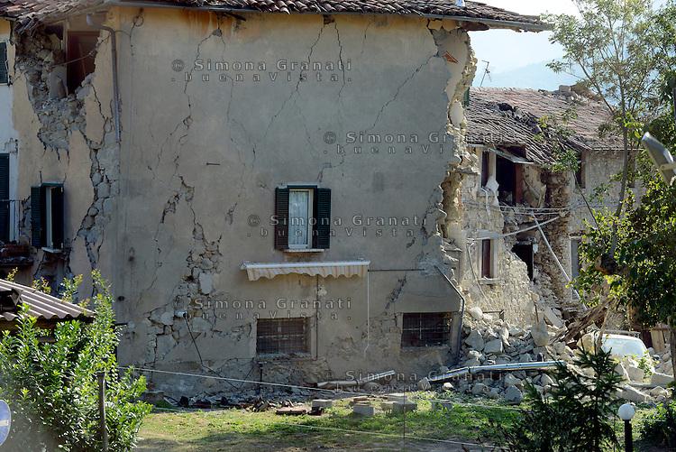 Illica, Rieti, 26 Agosto 2016.<br /> Edifici crollati ad Illica, frazione di Accumoli. <br /> L'Italia è stata colpita da un potente, terremoto di 6,2 magnitudo nella notte del 24 agosto, 2016, che ha ucciso almeno 290 persone .<br /> Collapsed buildings  in Illica, a hamlet of Accumoli, earthquake epicenter in central Italy was struck by a powerful, 6.2-magnitude earthquake in the night of August 24, 2016, Which has killed at least 290 people and devastated hundreds of houses.