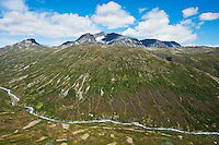 Surtningssue mountain peak rises above Memurudalen river valley, Jotunheimen national park, Norway