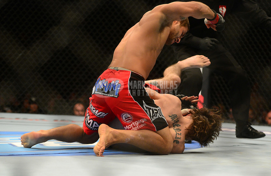 Jul. 7, 2012; Las Vegas, NV, USA; UFC fighter Chad Mendez (top) punches Cody McKenzie during a featherweight bout in UFC 148 at the MGM Grand Garden Arena. Mandatory Credit: Mark J. Rebilas-
