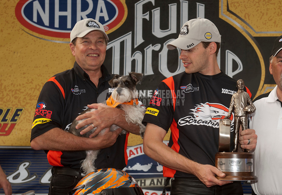 May 1, 2011; Baytown, TX, USA: NHRA pro stock motorcycle rider Andrew Hines (right) celebrates with Byron Hines after winning the Spring Nationals at Royal Purple Raceway. Mandatory Credit: Mark J. Rebilas-