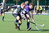 Andrew Smith (L) of Hampstead competes for the ball with Sam Ornbo of Sevenoaks during the England Hockey League Mens Semi-Final Cup game between Hampstead & Westminster and Sevenoaks at the Paddington Recreation Ground, Maida Vale on Sun March 21, 2010