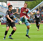 Burnley's Chris Wood and Crystal Palace's Scott Dann  during the premier league match at the Turf Moor Stadium, Burnley. Picture date 10th September 2017. Picture credit should read: Paul Burrows/Sportimage