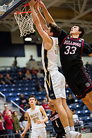 Springdale Bulldogs vs Bentonville West Woverines Basketball - Carl Fitch (33) of Springdale blocks the dunk by Collier Blackburn of Bentonville West at Wolverine Arena, Bentonville, AR on February 9, 2018.   Special to NWA Democrat-Gazette/ David Beach