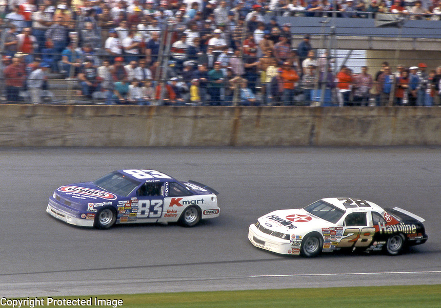 NASCAR Winston Cup drivers Lake Speed (83) and Davey Allison (28) race for position during  the Pepsi Firecracker 400 at Daytona International Speedway in Daytona Beach, FL on July 2, 1988. Speed finished 9th in the race while Allison finished 38th.   (Photo by Brian Cleary/bcpix.com)